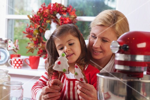 Mother and daughter looking at Christmas cookies in the kitchen