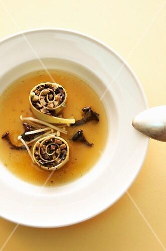 Bouillon with stuffed mushroom cannelloni