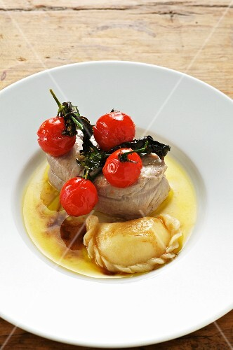 Steamed veal with potato pockets and tomatoes
