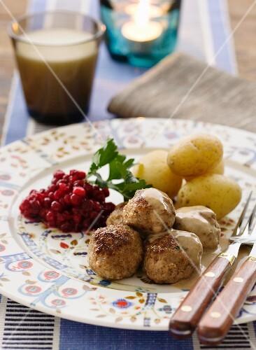Köttbullar (Swedish meatballs) with cranberries and potatoes