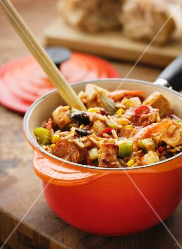 Rice casserole with chicken, pork, sausage and vegetables