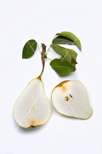A halved pear with leaves