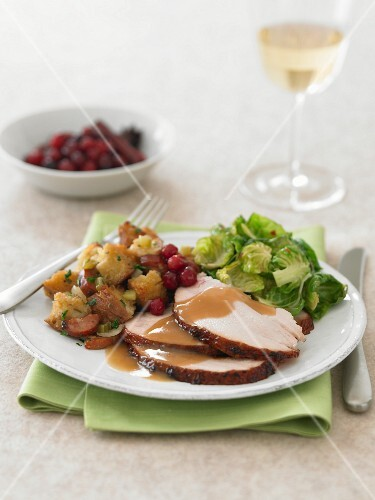 Plate of Sliced Turkey with Gravy, Stuffing and Brussels Sprouts