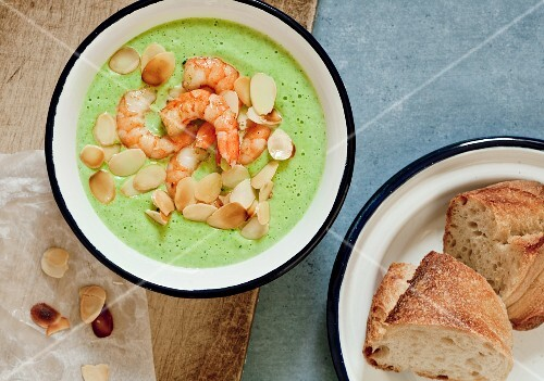 Cream of broccoli soup with shrimp and sliced almonds