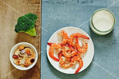 Ingredients for cream of broccoli soup with shrimp and sliced almonds