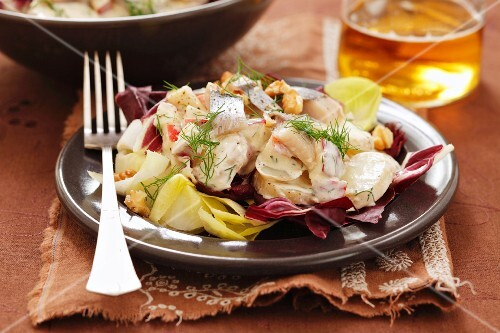 Potato and herring salad on a bed of chicory and radicchio