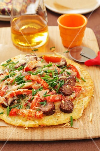 Potato pizza with sausage, pepper and cheese