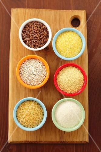 Bowls of buck wheat, polenta, barley, couscous, bulgur and semolina