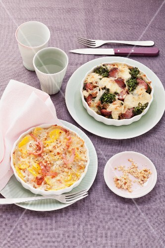 Potato gratin with kale and sausage and potato gratin with turnips and ham