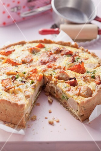 Vegetable and chicken quiche, cut