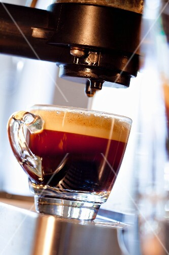 A cup of espresso with foam