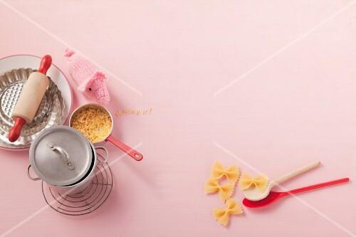 Still-life of pasta, saucepan and baking tins