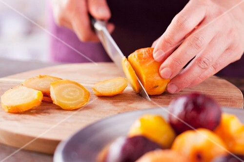 Slicing cooked yellow beetroot
