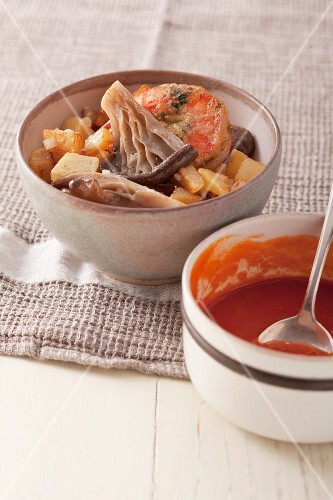 Fried herb prawns with potatoes, mushrooms and tomato suce