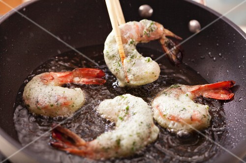 Frying prawns with herb and egg white coating