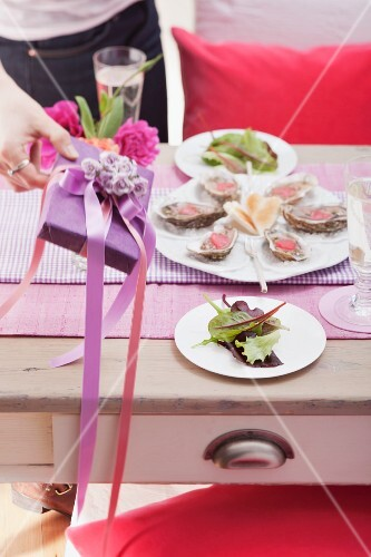 Table set for Valentine's Day with oysters