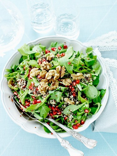 Mixed salad with pomegranate seeds and walnuts