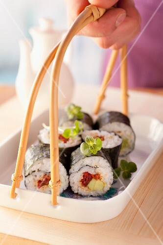 Maki sushi with dried tomatoes and avocado