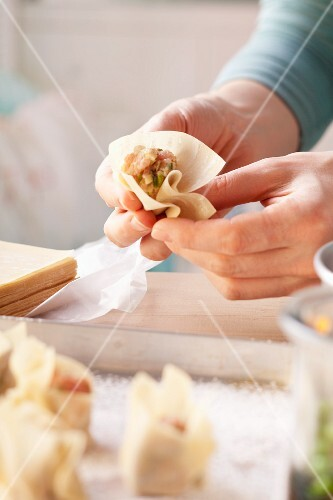 Meat-filled won tons being prepared