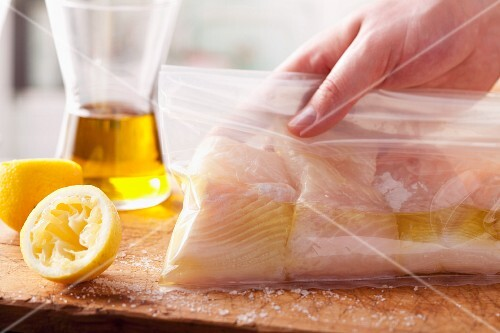 Halibut being marinated in a freezer bag
