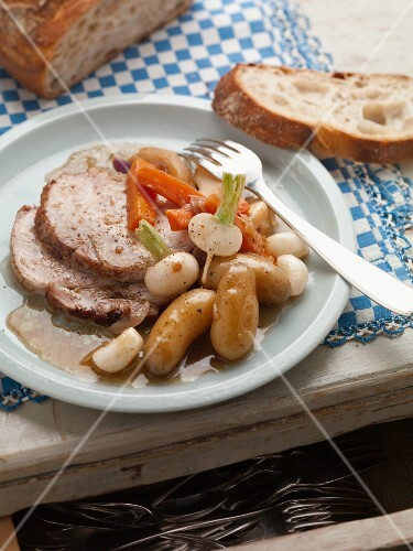 Roast pork with beets, carrots and potatoes (France)