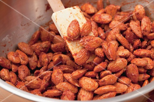 Making spiced sugar-toasted almonds