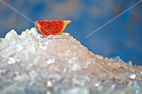 Piece of fresh fig on crushed ice