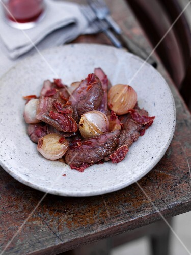 Fried pork liver with Serrano ham and pearl onions in sweet sherry