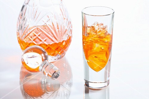 Orange liqueur in a glass and in a carafe