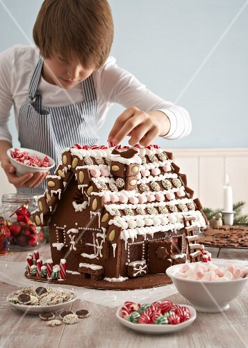 Decorating a gingerbread house