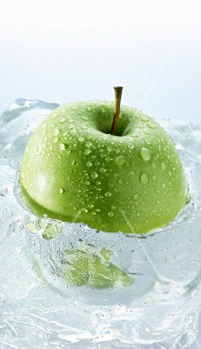 Granny Smith apple in a block of ice