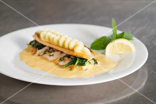 Königsee char with creamy mashed potatoes on a bed of spinach
