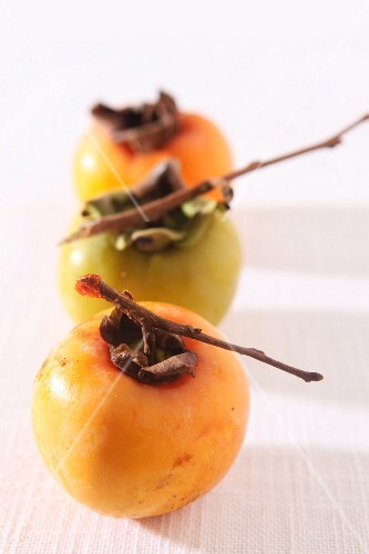 Fresh persimmons with twigs