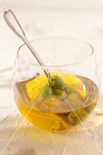 Glass with olives and olive oil