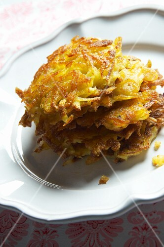 A stack of potato rösti (hash browns) on a plate