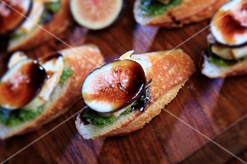 Appetizers of French Bread Slices Topped with Le Brin Brie Cheese, Fig and Balsamic Glaze