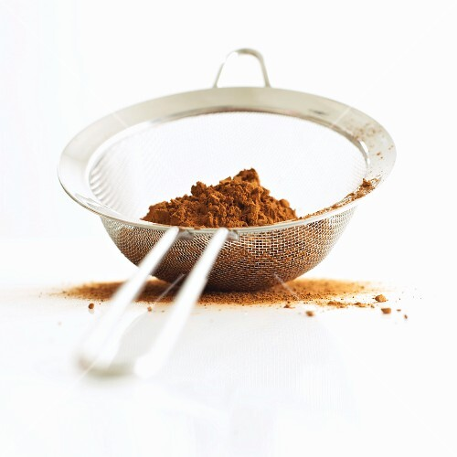 Cocoa powder in a sieve