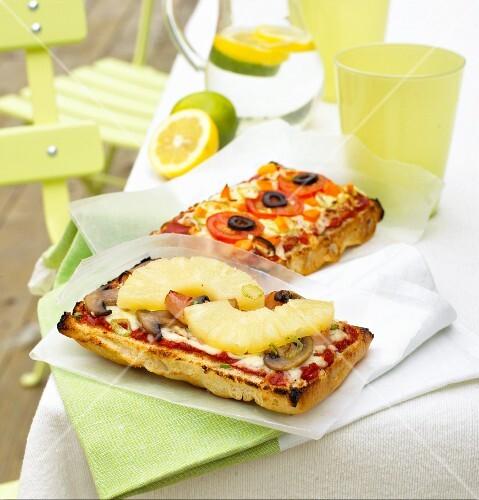 Two different focaccia pizzas
