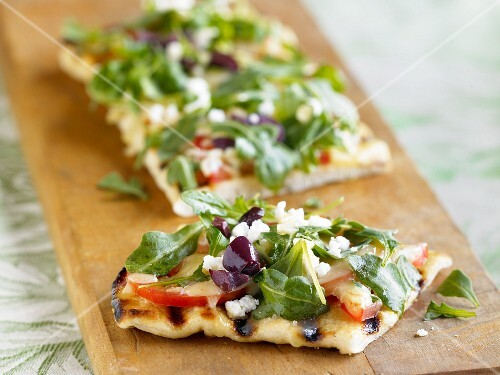 Grilled Focaccia Bread Topped with Arugula, Tomatoes and Crumbled Queso Cheese