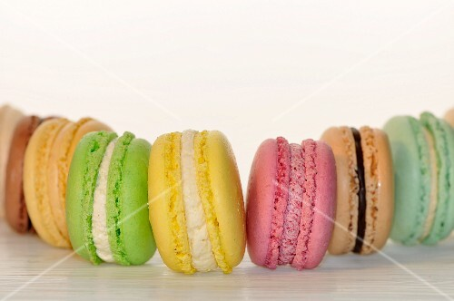 A row of different coloured macaroons