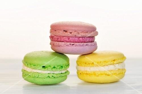 Three macaroons (green, pink, yellow)