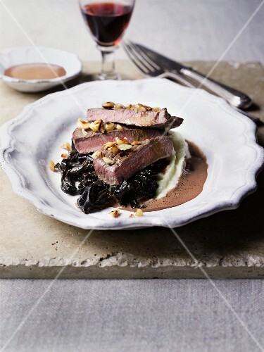 Venison fillet on a bed of mashed potatoes with prunes