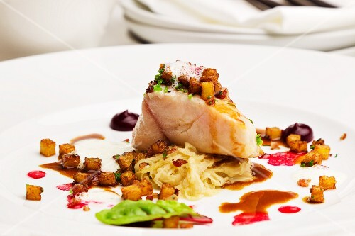 Catfish fillet with sauerkraut and beetroot essence