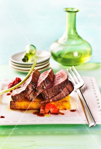 Roast beef on polenta with strawberry sauce