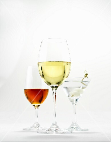 A glass of white wine, a martini and a glass of sherry