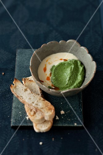 Spinach puree on almond cream with tomato and chilli oil