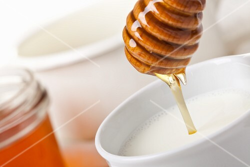 A cup of hot milk and honey