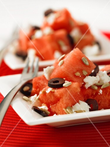 Watermelon salad with feta cheese, olives and sunflower seeds