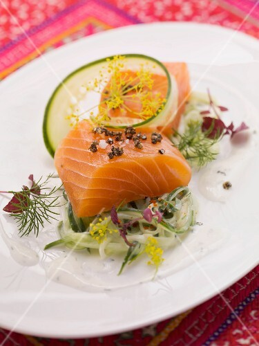 Marinated salmon on a cucumber and ginger salad with sour cream