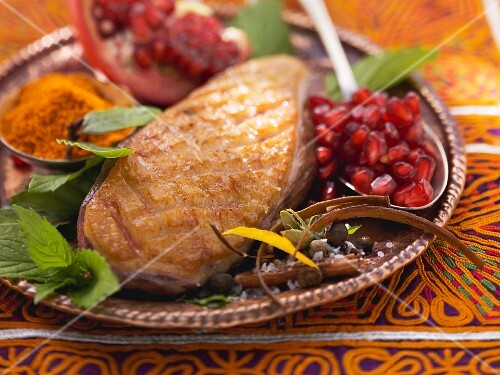 Fried duck breast with pomegranate seeds